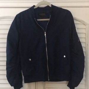 Navy jacket with ruched sleeves.
